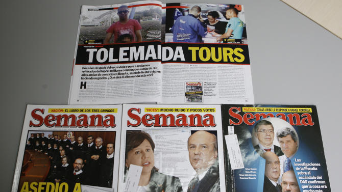 This Thursday, May 9, 2013 photo, shows issues of Semana magazine featuring investigative reports written by journalist Ricardo Calderon, in Bogota, Colombia. Calderon's most recent investigative series for Semana magazine exposed the scandalously luxurious life of military officers jailed for crimes including murder and genocide at Tolemaida army base. (AP Photo/Ricardo Mazalan)