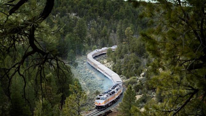 This photo provided by Grand Canyon Railway shows the train on its daily run between Williams, Arizona, and the Grand Canyon's South Rim. The railway has been running since 1901, carries 225,000 people a year and offers history, sightseeing, scenery and entertainment. (AP Photo/Grand Canyon Railway)