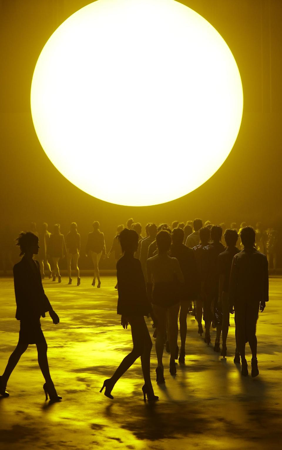 Models are shown beneath a huge sun during the Marc Jacobs Fall 2013 fashion show Fashion Week in New York, Thursday, Feb. 14, 2013.  (AP Photo/Kathy Willens)