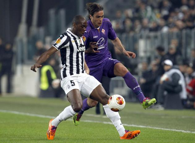 Juventus' Ogbonna fights for the ball with Fiorentina's Matri during their Europa League round of 16 first leg soccer match at the Juventus stadium in Turin