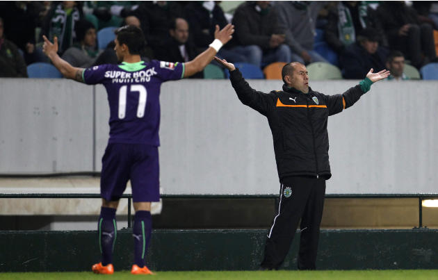 Sporting's Jardim and Montero react during their Portuguese Premier League soccer match against Nacional in Lisbon