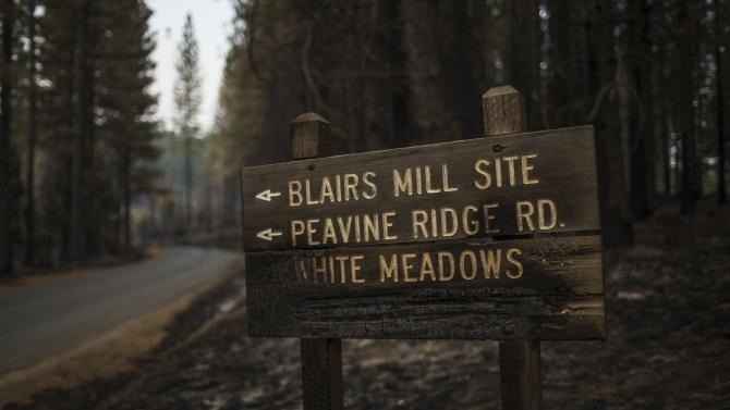 A road sign burned by the King Fire is seen in Pollock Pines, California