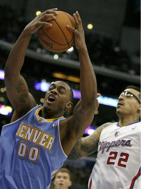 Denver Nuggets forward Darrell Arthur (00) pulls down a rebound in front of Los Angeles Clippers forward Matt Barnes (22) in the second half of an NBA basketball game in Los Angeles on Saturday, Dec.