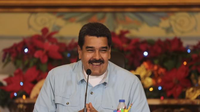 Venezuela's President Nicolas Maduro smiles during  meeting with governors and ministers at Miraflores Palace in Caracas