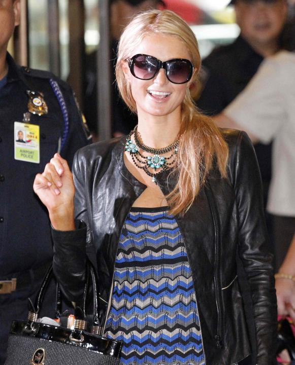 U.S. actress and model Paris Hilton smiles upon arrival at the international airport in Manila