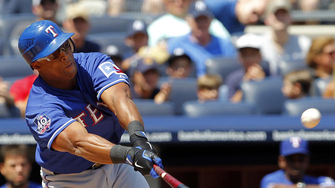 Texas Rangers' Adrian Beltre hits the ball softly to centerfield for a two-RBI single in the first inning of a baseball game against the New York Yankees at Yankee Stadium in New York, Thursday, Aug. 16, 2012. (AP Photo/Paul J. Bereswill)