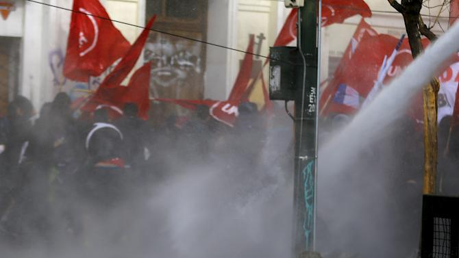 Universidad Catolica de Valparaiso student Rodrigo Aviles Bravo is pictured as police fired water cannons to disperse crowds during a rally in Valparaiso
