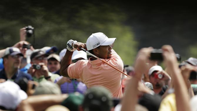Tiger Woods tees off on the first hole during a practice round for the Masters golf tournament Tuesday, April 9, 2013, in Augusta, Ga. (AP Photo/Charlie Riedel)