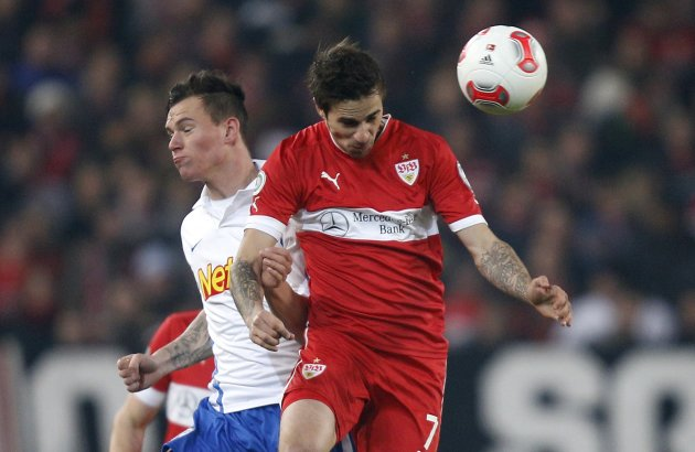 VfB Stuttgart's Harnik challenges Vfl Bochum's Scheidhauer during their German soccer cup (DFB Pokal) quarter final match in Stuttgart