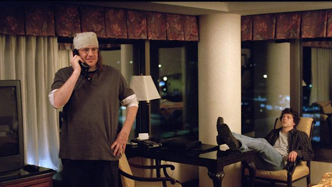 """This image released by A24 Films shows, Jason Segel, left, as David Foster Wallace, and Jesse Eisenberg as David Lipsky, in a scene from the film, """"The End of the Tour."""" (A24 Films via AP)"""