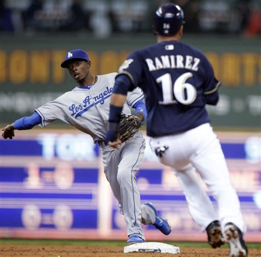 Dodgers beat Brewers 4-3 to avoid sweep