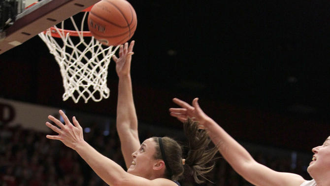 Connecticut guard Kelly Faris (34) drives to the basket against Stanford forward Mikaela Ruef (3) as guard Jasmine Camp (23) looks on during the first half of an NCAA college basketball game in Stanford, Calif., Saturday, Dec. 29, 2012. (AP Photo/Tony Avelar)