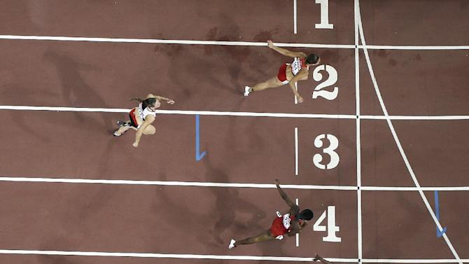 Jamaica's Danielle Williams, lane 5, crosses the finish line to win the women's 100m hurdles final at the World Athletics Championships at the Bird's Nest stadium in Beijing, Friday, Aug. 28, 2015. (AP Photo/David J. Phillip)