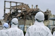 "Members of a Japanese government panel investigate the accident at Fukushima nuclear power plant in June 2011. The nuclear accident at Fukushima last year was a ""man-made disaster"" and not only due to the tsunami, a Japanese parliamentary panel said Thursday in its final report on the catastrophe"