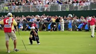 Adam Scott of Australia reacts after missing his putt to tie the championship on the 18th green during his final round on day four of the 2012 Open Championship at Royal Lytham and St Annes in Lytham. Ernie Els won the championship with a score of 273
