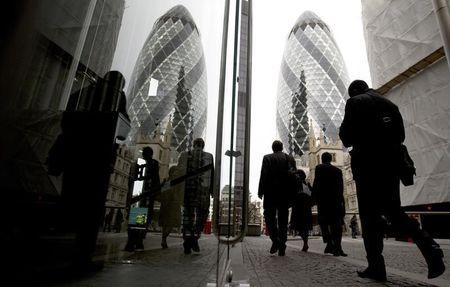 Workers walk through the City of London