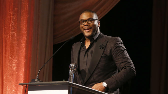 "Orchid Humanitarian Award Winner Tyler Perry at the CARRY Foundation's 7th Annual ""Shall We Dance"" Gala at The Beverly Hilton Hotel on Saturday, May 11, 2013 in Beverly Hills, California.  (Photo by Todd Williamson/Invision for CARRY Foundation/AP Images)"
