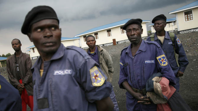 Congolese policemen gather at the Mugunga police training center near the eastern Congolese town of Goma, Friday Nov. 23, 2012. The officers were called by M23 rebel officials to receive an ideological briefing. Platoons of rebels were making their way across the hills from Sake to the next major town of Minova, where the Congolese army was believed to be regrouping. The militants seeking to overthrow the government vowed to push forward despite mounting international pressure. (AP Photo/Jerome Delay)