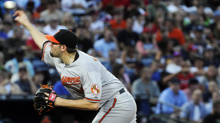 Baltimore Orioles pitcher Jason Hammel works the mound against the Atlanta Braves during the fifth inning of a baseball game on Saturday, June 16, 2012, in Atlanta. (AP Photo/John Amis)