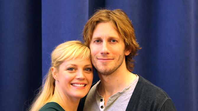 "In this Nov. 18, 2015 photo, Elizabeth Stanley and Andrew Samonsky pose for a photo in New York. The couple star in a national tour of ""The Bridges of Madison County,"" a musical based on the Robert James Waller novel, which was made into a 1995 movie starring Meryl Streep and Clint Eastwood. The show is about a four-day love affair in 1965 between a world-weary photographer and an Italian-American housewife. (AP Photo/Mark Kennedy)"