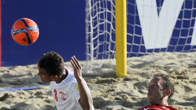 Tahiti's Tainui, left, vies for the ball with Portugal's Jose Maria during their FIFA Beach Soccer World Cup final match in Espinho, Portugal, Sunday, July 19, 2015. Portugal won 5-3.(AP Photo/Paulo Duarte)