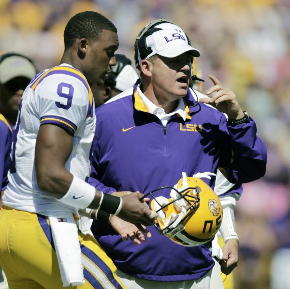 LSU coach Les Miles sends quarterback Jordan Jefferson (9) into the game against Kentucky in the first quarter of an NCAA college football game in Baton Rouge,  La., Saturday, Oct. 1, 2011. (AP Photo/Gerald Herbert)
