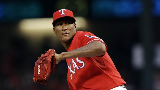 Texas Rangers starting pitcher Alexi Ogando (41) throws during the first inning of a baseball game against the Tampa Bay Rays, Monday, April 8, 2013, in Arlington, Texas. (AP Photo/LM Otero)