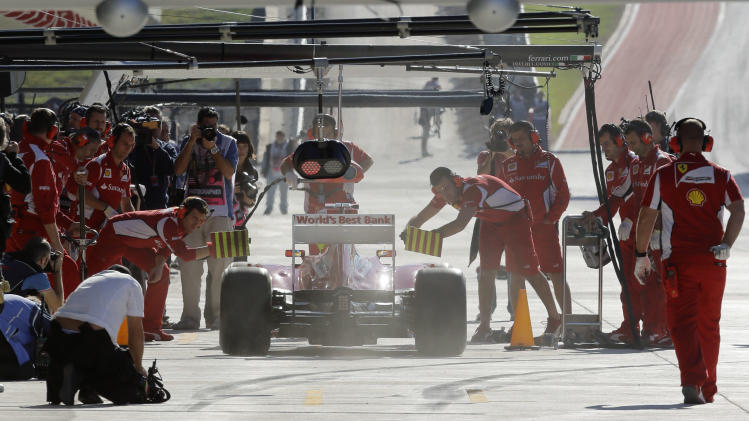 Ferrari driver Fernando Alonso of Spain gets a pit service during the first free practice session for the Formula One U.S. Grand Prix, at the Circuit of the Americas race track in Austin, Texas, Friday, Nov. 16, 2012.  (AP Photo/Luca Bruno)