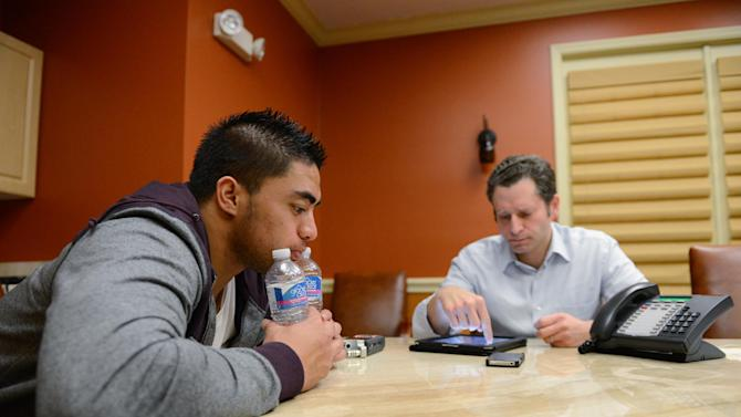 """In a photo provided by ESPN, Notre Dame linebacker Manti Te'o pauses during an interview with ESPN's Jeremy Schaap, right, on Friday, Jan. 18, 2013, in Bradenton, Fla. ESPN says Te'o maintains he was never involved in creating the dead girlfriend hoax. He said in the off-camera interview: """"When they hear the facts they'll know. They'll know there is no way I could be a part of this."""" (AP Photo/ESPN Images, Ryan Jones) MANDATORY"""