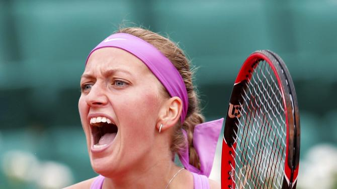 Petra Kvitova of the Czech Republic reacts during the women's singles match against Silvia Soler Espinosa of Spain at the French Open tennis tournament at the Roland Garros stadium in Paris