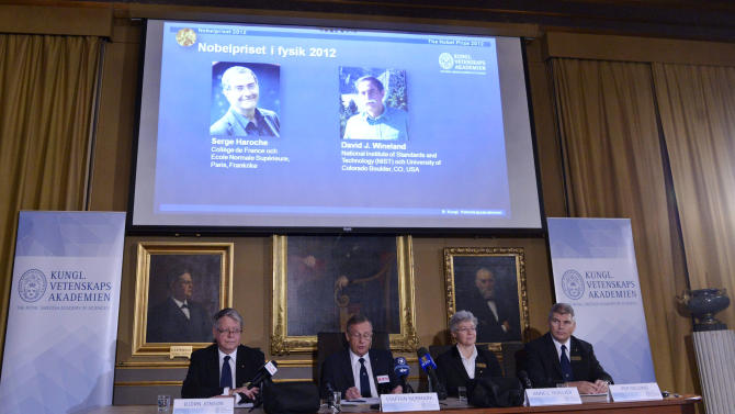 "Photographs of the 2012 Nobel Prize laureates in Physics Serge Haroche from France, left, and David Wineland from the US are presented on a screen during a media conference at the Royal Swedish Academy of Science in Stockholm, Sweden, Tuesday Oct. 9, 2012.  Frenchman Serge Haroche and American David Wineland have won the 2012 Nobel Prize in physics for inventing and developing methods for observing tiny quantum particles without destroying them. The Royal Swedish Academy of Sciences cited the two scientists Tuesday ""for ground-breaking experimental methods that enable measuring and manipulation of individual quantum systems.""   (AP Photo / Bertil Enevag Ericson / SCANPIX)    SWEDEN OUT"