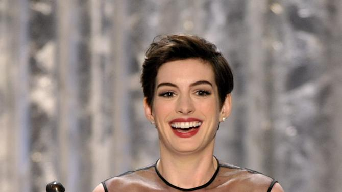 """Anne Hathaway accepts the award for outstanding female actor in a supporting role for """"Les Miserables"""" at the 19th Annual Screen Actors Guild Awards at the Shrine Auditorium in Los Angeles on Sunday, Jan. 27, 2013. (Photo by John Shearer/Invision/AP)"""