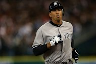 Alex Rodriguez of the New York Yankees walks off the field after he grounded out in the top of the 9th inning against the Detroit Tigers during game four of the American League Championship Series at Comerica Park on October 18
