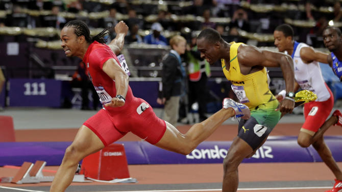 File - United States' Aries Merritt, left, crosses the finish line in the men's 110-meter hurdles final to win gold ahead of Jamaica's Hansle Parchment during the athletics in the Olympic Stadium at the 2012 Summer Olympics, London, in this Wednesday, Aug. 8, 2012 file photo. Olympic hurdles champion Merritt is facing some of his toughest competition at the IAAF's 100th anniversary gala. Three months after winning the 110-meter hurdles at the London Games, Merritt will be up against Usain Bolt and 800-meter gold medalist David Rudisha for the IAAF's World Athlete of the Year award.  (AP Photo/David J. Phillip, file)