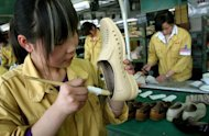 File picture of a factory worker gluing leather shoes at the Kangnai shoe factory in Wenzhou. In recent days, the name of a mid-sized Chinese coastal city has percolated through official Washington as quickly as a viral photograph of a nude Congressman