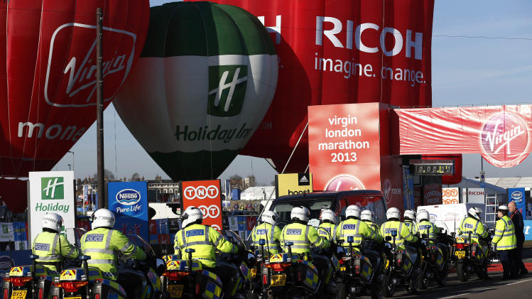 British police officers gather at the start at Blackheath during the London Marathon in London, Sunday, April 21, 2013. The London Marathon started as planned on a glorious sunny morning Sunday despite concerns raised by the bomb attacks on the Boston Marathon six days ago. (AP Photo/Sang Tan)