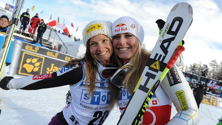 Lindsey Vonn, right, of the United States, celebrates with her teammate third placed Julia Mancuso after winning an alpine ski, women's World Cup super-G, in St. Moritz, Switzerland, Saturday, Dec .8, 2012. (AP Photo/Giovanni Auletta)