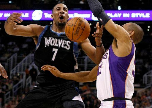 Hill, Suns pull away from weary Minnesota 104-95