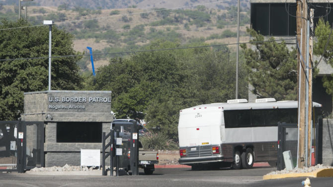 A bus carrying children arrives to a border patrol facility in Nogales, Ariz., Saturday, June 7, 2014. Arizona officials said that they are rushing federal supplies to a makeshift holding center in the southern part of the state that's housing hundreds of migrant children and is running low on the basics. (AP Photo/The Arizona Republic, Patrick Breen) MARICOPA COUNTY OUT; MAGS OUT; NO SALES