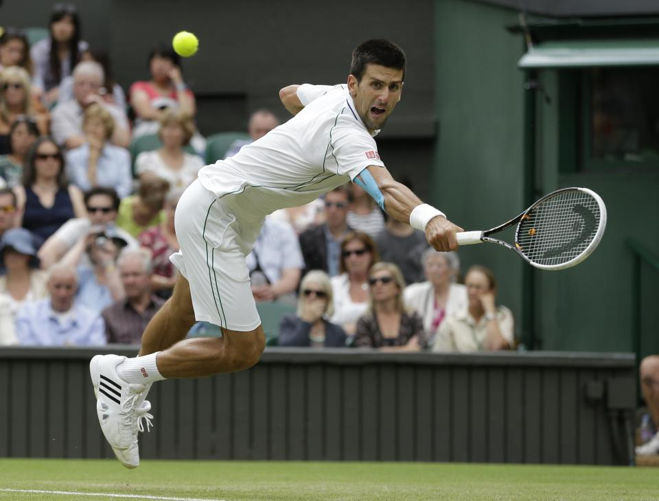 Novak Djokovic of Serbia reaches for a shot by Radek Stepanek of the Czech Republic during a third round men's singles match at the All England Lawn Tennis Championships at Wimbledon, England, Friday, June  29, 2012. (AP Photo/Alastair Grant)