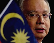 Malaysian Prime Minister Najib Razak looks on during a press conference in Kuala Lumpur, on March 19, 2013. Razak has dissolved parliament in preparation for a general election seen as the toughest challenge yet for the ruling coalition after 56 years in power
