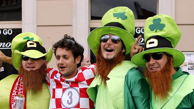 Ireland and a Croatia fan party ahead of the group B match between Republic of Ireland and Croatia during the  Euro 2012 soccer championship in Poznan, Poland, Sunday, June 10, 2012. (AP Photo/Peter Morrison)
