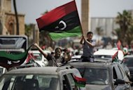 Libyans celebrate in Martyrs' Square in Tripoli after voting for the Libyan General National Assembly on July 7, 2012. Libya's new congress is tasked with appointing a new interim government and steering the country for a roughly one-year transition period, until fresh elections can be held on the basis of a new constitution