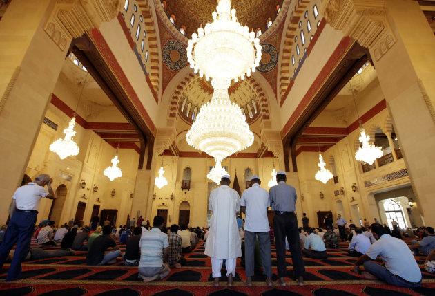 Muslims offer Friday prayers at Mohammed Al-Amin Mosque in downtown Beirut, Lebanon, Friday, Aug. 5, 2011. Muslims throughout the world are marking the holy month of Ramadan, where observants fast fro