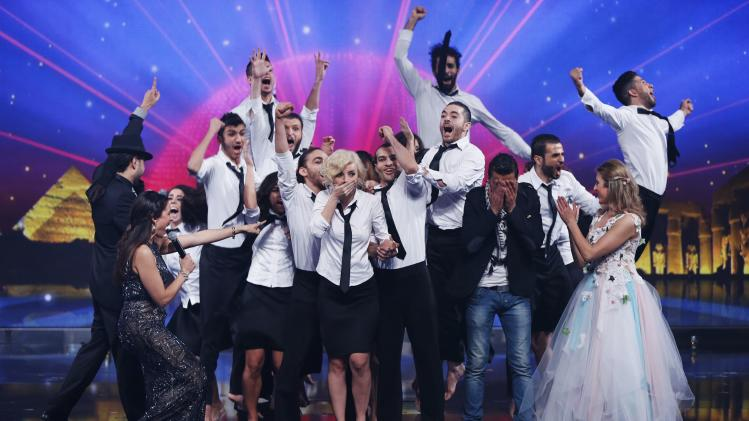 "Members of the Syrian Sima dance group react after they were announced winner of the Season 3 finale of ""Arabs Got Talent"" in Zouk Mosbeh area, north of Beirut"