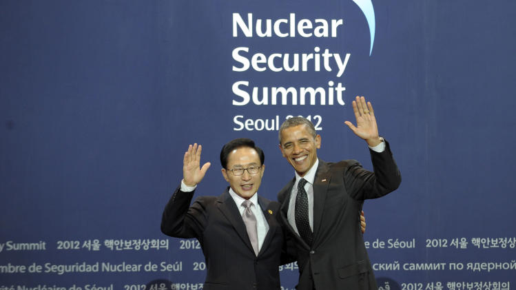 South Korean President Lee Myung-bak poses for a photo with President Barack Obama during a welcome ceremony for the Nuclear Security Summit at the Coex Center, in Seoul, South Korea, Monday, March 26, 2012. (AP Photo/Susan Walsh)