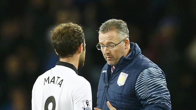 Aston Villa manager Paul Lambert speaks to Manchester United's Juan Mata on the final whistel after their English Premier League soccer match at Villa Park in Birmingham