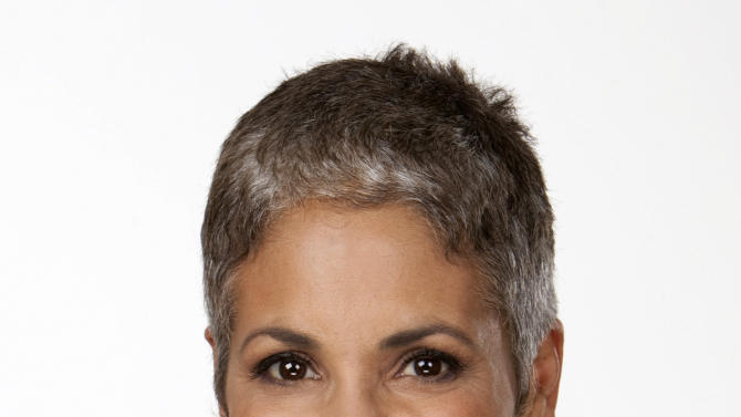In this 2011 photo released by KPIX-TV, San Francisco's KPIX news anchor Dana King is shown. King, 53, started going gray in her 20s, then dyed her hair in her 30s, and stopped a few years ago. She is among a new type of gray panther, a woman who aspires to do well and get ahead on the job while happily maintaining a full head of gray. (AP Photo/KPIX-TV)