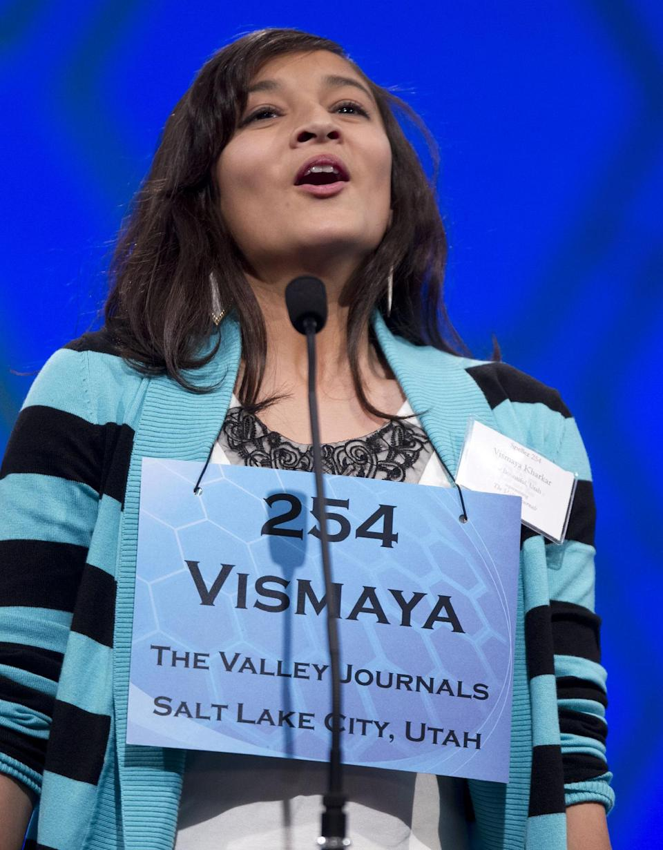 "Vismaya Jui Kharkar, of Bountiful, Utah, lets out a sigh of relief after spelling ""dysthymia"" during the semifinal round of the National Spelling Bee, Thursday, May 31, 2012, in Oxon Hill, Md.  (AP Photo/Evan Vucci)"