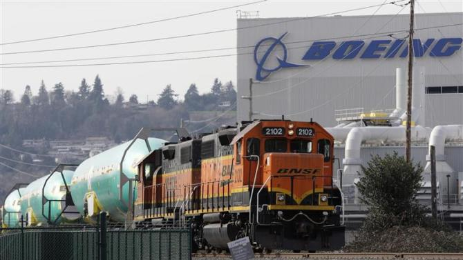 Boeing 737 fuselages are delivered by BNSF train to a Boeing manufacturing site in Renton